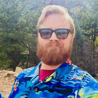 Nathan Kahre outside in brightly colored shirt